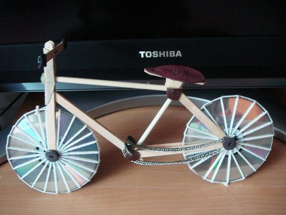 废旧物品制作的自行车(光盘)—儿童手工制作网