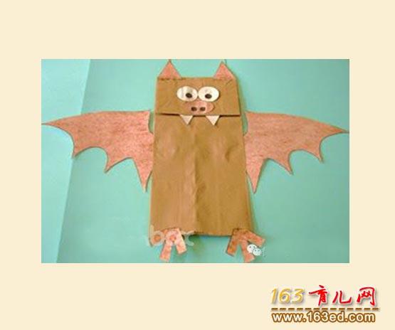 怎样用废旧牛皮纸袋制作一只长牙齿的蝙蝠?图片