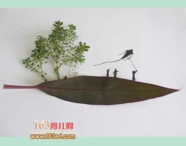 放风筝的小孩子_儿童树叶粘贴画作品图片