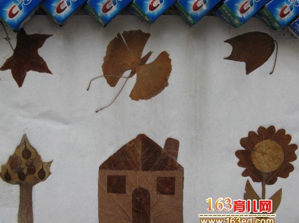 儿童树叶粘贴画作品:房子上的蝴蝶